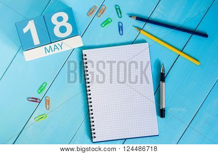 May 18th. Image of may 18 wooden color calendar on blue background.  Spring day, empty space for text.  International Museum Day.