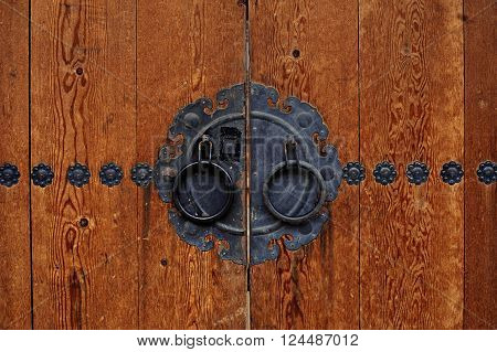 wooden door with steel plate at the center