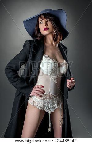 Studio portrait of pretty glamorous woman dressed sexy