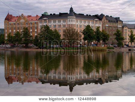 Helsinki: Reflection of beautiful houses in inner bay-lake of Helsinki.
