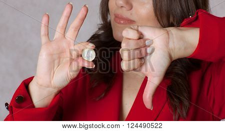 One Euro Coin In The Hand Of A Young Woman.