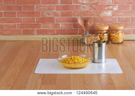 corn in the glass bowl and can on kitchen counter with blank space