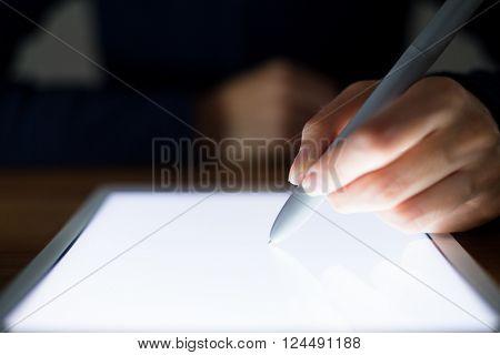 Woman writing something on digital tablet