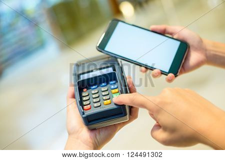 Customer using cellphone for pay on pos machine