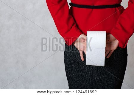 A Roll Of A Toilet Paper In The Hand Of A Young Woman