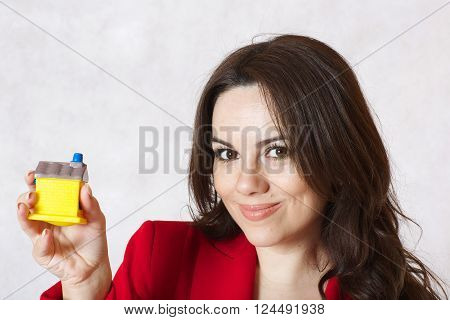A Lady Keeps A Small Rubber House