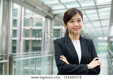 Young asian businesswoman in business district of Hong Kong
