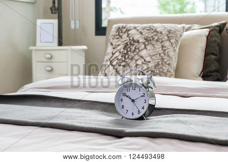Classical Alarm Clock On Bed