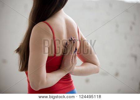 Yogi Woman Holding Anjali Mudra Behind The Back