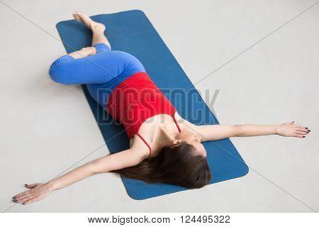 Yoga Indoors: Revolved Abdomen Pose