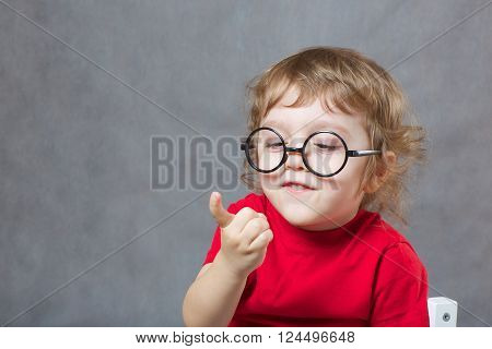 A Boy Of Three Years Is Showing His Index Finger