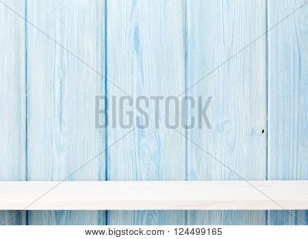 Wood shelf in front of wooden wall. View with copy space