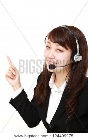 young Japanese businesswoman of call center with head sets presenting