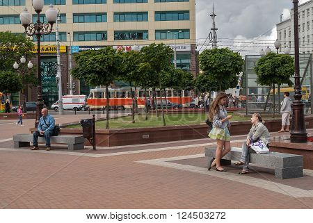 Kaliningrad, Russia - June 21, 2010: People rest on Victory square in city center
