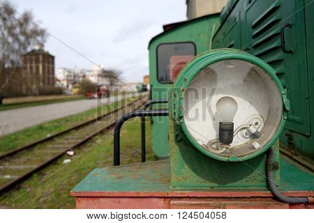 Headlight of a historic locomotive in the port of Magdeburg