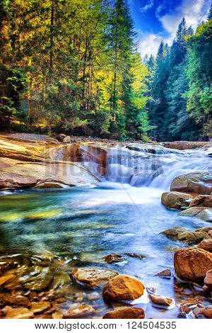 Beautiful waterfall in the forest,  fresh water flows between stones and rocks, wonderful landscape, wild nature's beauty of Ukraine