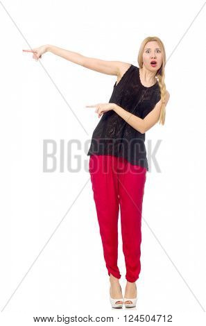 Tall young woman in red pants isolated on white
