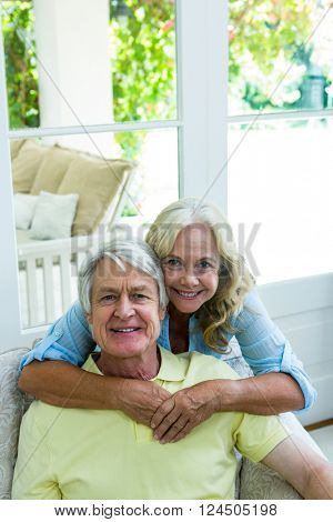 Happy senior couple embracing at home