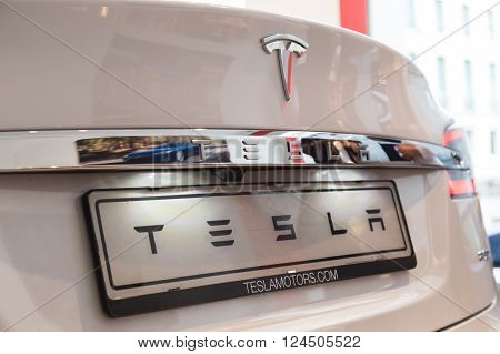 MILAN ITALY - MARCH 31 2016: Detail of Tesla Model S 90D car. Tesla Motors is an American company that designs manufactures and sells cutting edge electric cars.