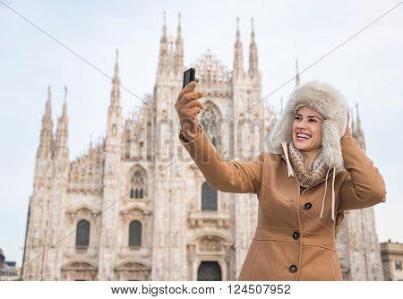 Woman Taking Selfies With Digital Camera While Sightseeing Milan