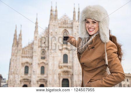 Woman Tourist Taking Photos Of Duomo While Sightseeing Milan