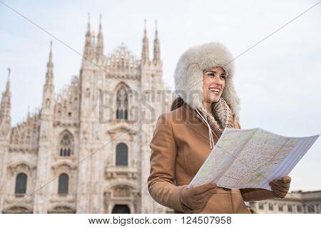 Smiling Woman Traveler With Map Looking Aside Near Duomo, Milan