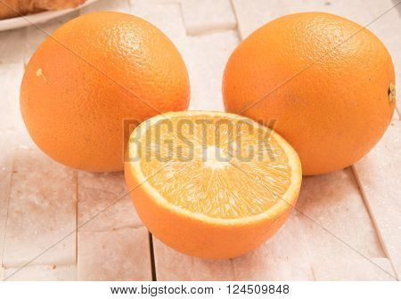 Orange fruit on a white  marble background