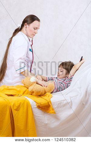 Pediatrician and a child of six years old. White background