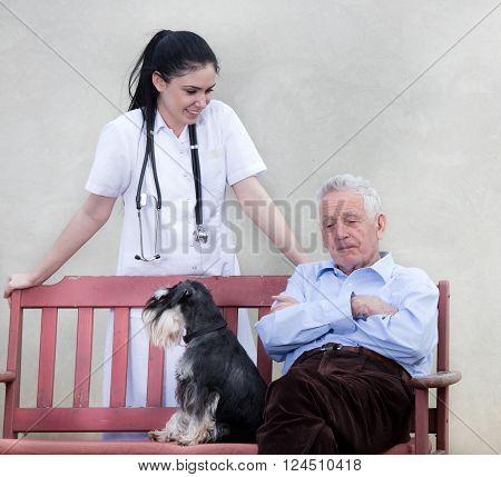 Senior Man With Caregiver And Dog