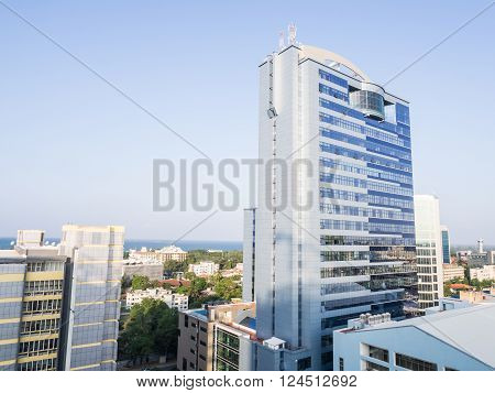 DAR ES SALAAM TANZANIA - MARCH 23 2016: Architecture in downtown of Dar es Salaam Tanzania East Africa in the evening light. Horizontal orientation wide angle.