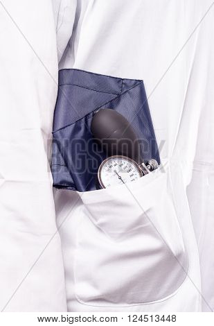 Blood pressure gauge sphygmomanometer in the doctora lab coat ready for use in the medical check up