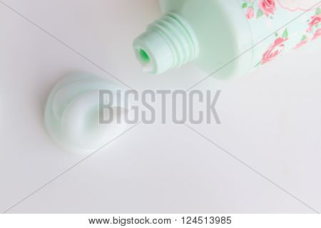 Squirt of cosmetic cream next to an open tube ** Note: Soft Focus at 100%, best at smaller sizes