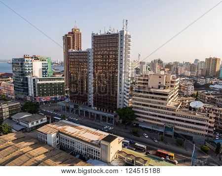DAR ES SALAAM TANZANIA - MARCH 23 2016: Architecture in downtown of Dar es Salaam Tanzania East Africa in the evening at sunset. Horizontal orientation wide angle.