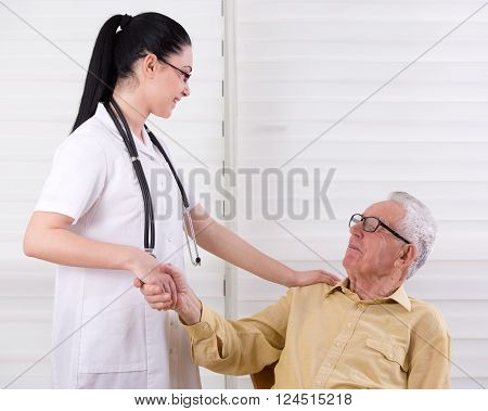 Nurse And Senior Man Shaking Hands