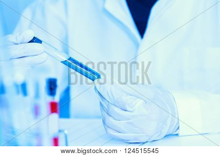Scientist with laboratory background and concept .