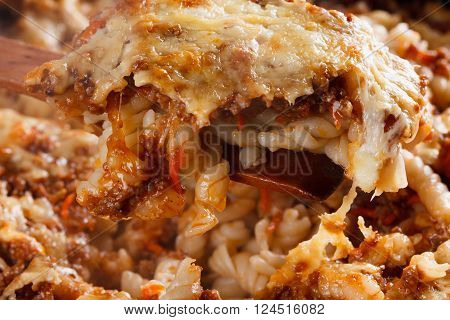 Recently homemade cooked pasta with meat cheese and tomato