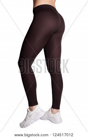 pretty womens ass in tight tights on white background