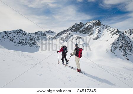 Pair of climbers practice ski mountaineering to the summit