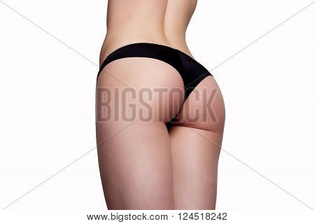 beauty girl back in pants string isolated over white background
