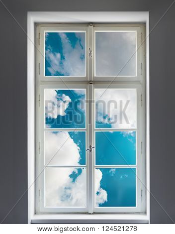 Classic white window and the clouds