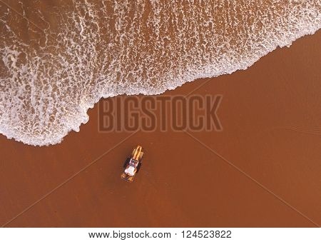 Top view air shooting from flying rotorcraft of hipster girl is using laptop for remote work while is lying on sunbed near sea with copy space background for your advertising text message or content ** Note: Visible grain at 100%, best at smaller sizes