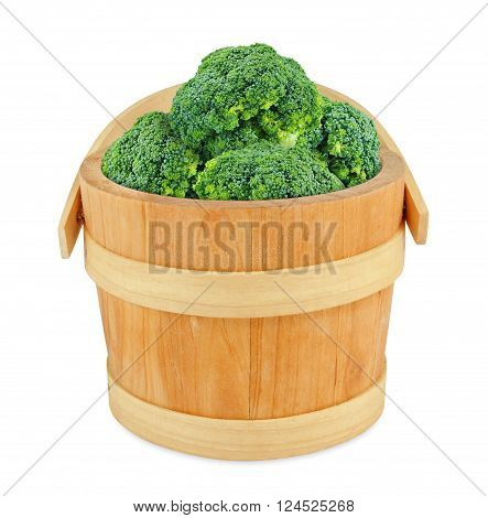 broccoli in a wooden bucket isolated on white broccoli