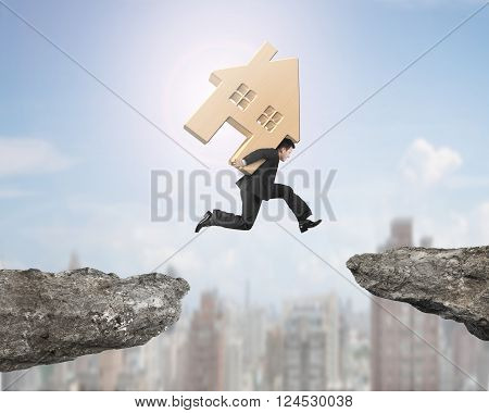 Man carrying wooden house jumping over two cliffs with sunny sky city buildings background, 3D Illustration.