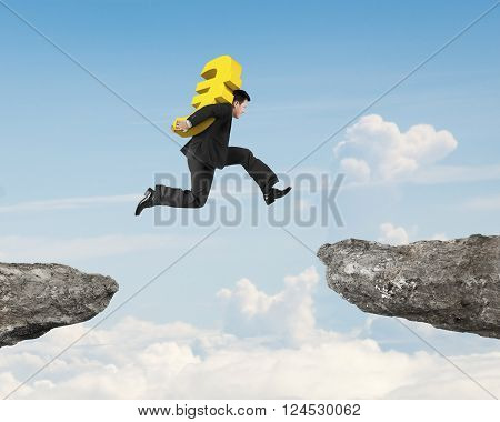 Man carrying golden euro sign jumping over two cliffs with sky clouds background, 3D Illustration.