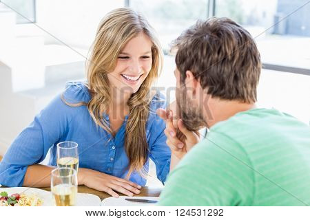 Man kissing a woman's hand at home