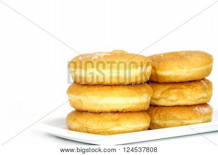 Morning breakfast with donuts and sugar on white backgound