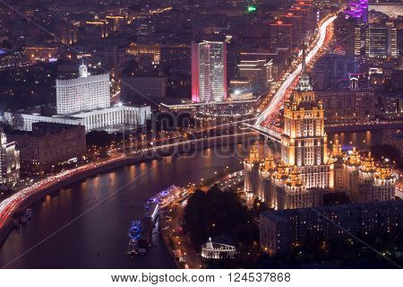 Ukraine hotel, government building and New arbat street at night in Moscow, Russia, top view