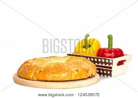 Composition with bread and vegetable in basket isolated on white backgound