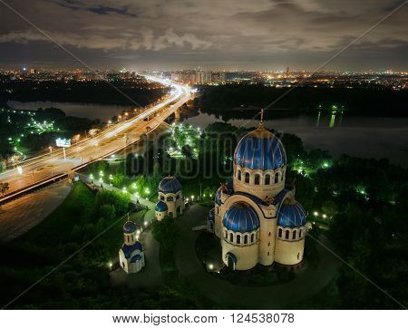 Temple of Holy Trinity, highway and panorama of Mosocw at night, Russia