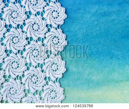 Vintage background with cotton lace crochet. Knitted background on paper. Knitted frame with handmade lace. Christmas and Valentine's day background.